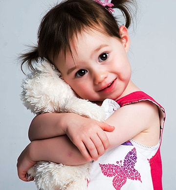 Little girl hugging a bear