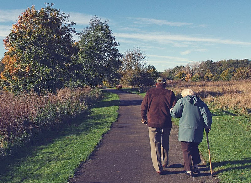 Old Couple Walking Down a Path